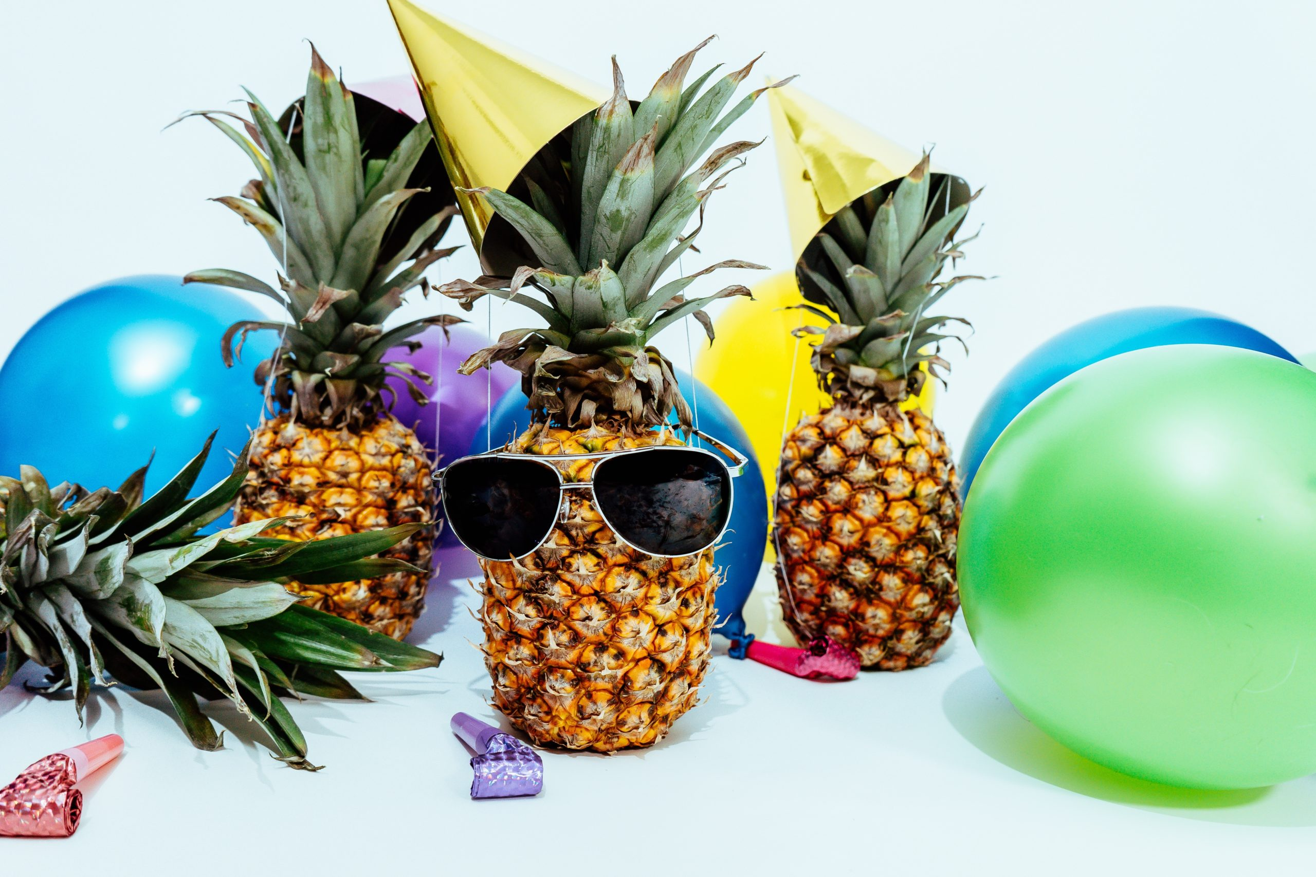 photo-of-three-pineapples-surrounded-by-balloons-PineappleSupply